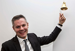 "Derek Mackay, Finance Secretary rings the ""Success Bell"" at the official opening of the building services firm's office at Ratho, Edinburgh. The bell is rung to mark achievements by the company and its employees. Pic: Terry Murden @edinburghelitemedia"