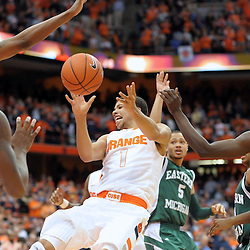 Syracuse Orange guard MICHAEL CARTER-WILLIAMS (1) tries to dish the ball while in the middle of the Eastern Michigan Eagles defense during the second half at the Carrier Dome in Syracuse, New York. Number four ranked Syracuse defeated Eastern Michigan 84-48 in front of a crowd of 20,822.