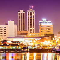 Peoria Illinois skyline panorama picture at night. Panoramic photo ratio is 1:3 and includes downtown city skyline buildings along the Illinois River.