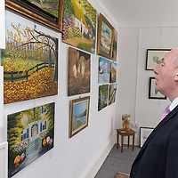 Michael RIng, TD, Junior Minister for Sports, admiring some local art and paintings at the Official opening of 'The Castle', Antique, Arts & Craft Centre in Clarecastle