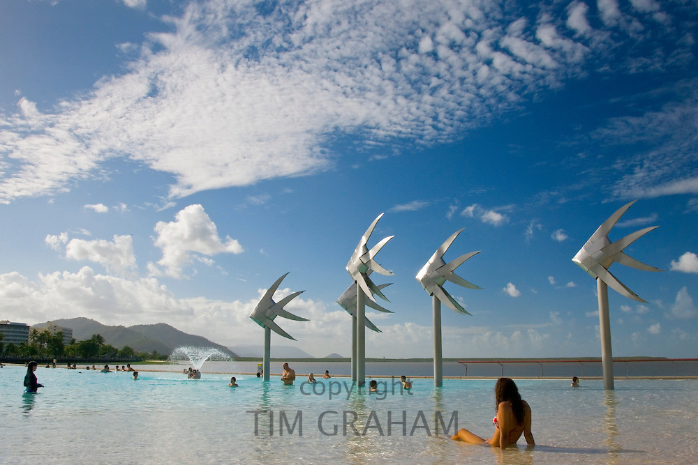 Young woman sunbathing in the Cairns Esplanade Lagoon, a waterpark in Queensland, Eastern Australia