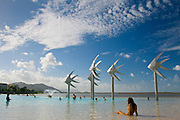 Young woman sunbathing in the Cairns Esplanade Lagoon, a waterpark in Queensland, Eastern Australia