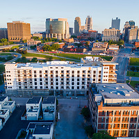 Aerial view of 531 Grand mixed use residential and commercial construction project underway in May 2017, River Market area of Kansas City, Missouri; developed by Cornerstone Associates, designed by NSPJ Architects