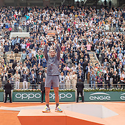 PARIS, FRANCE June 09.  Rafael Nadal of Spain with the trophy as he holds it aloft to the packed Court Philippe-Chatrier after his victory against Dominic Thiem of Austria during the Men's Singles Final at the 2019 French Open Tennis Tournament at Roland Garros on June 9th 2019 in Paris, France. (Photo by Tim Clayton/Corbis via Getty Images)
