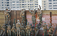 Marines construct barbed wire fencing along the United States-Mexico border in San Ysidro, California on Friday, November 9, 2018.