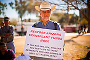 "14 FEBRUARY 2011 - PHOENIX, AZ:  DENNIS HOWERTON, from Maricopa, AZ, pickets Gov. Jan Brewer's speech during Statehood Day observances at the State Capitol in Phoenix Monday. Brewer cut state health insurance funding for medical transplant patients in an effort to balance the state budget. The move has been very unpopular with the public, who have called it the imposition of ""Death Panels."" So far Brewer has refused to reconsider restoring the cuts. Arizona became the 48th state in the United States on Feb. 14, 1912. Gov. Brewer announced that the state is planning a series of centennial events leading up to Feb 14, 2012 for the coming year during her speech at the state capitol Monday morning.    Photo by Jack Kurtz"