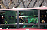 Bus carries workers home in rush hour, Xian city centre, China