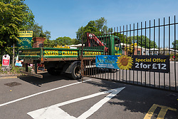 "© Licensed to London News Pictures. 09/05/2020. LONDON, UK.  A lorry arrives at the entrance to Ducks Hill Garden Centre in Ruislip, north west London, currently closed, during the ongoing coronavirus pandemic lockdown.  Boris Johnson, Prime Minister, is due to deliver a ""roadmap"" speech on Sunday 10 May to unveil the government's plans on lifting lockdown restrictions and garden centres are expected to be allowed to reopen.  Photo credit: Stephen Chung/LNP"
