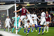 Burnley defender James Tarkowski 5) heads back across goalo during the Premier League match between Burnley and Chelsea at Turf Moor, Burnley, England on 26 October 2019.