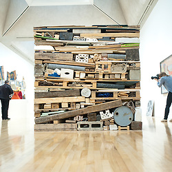 """London, UK - 13 May 2013: A photographer takes a picture next to a work by Tony Cragg entitled """"Stack 1975"""". The new chronological presentation of the world's greatest collection of British art will allow visitors to experience the national collection of British art in a continuous chronological display from the 1500s to the present day."""
