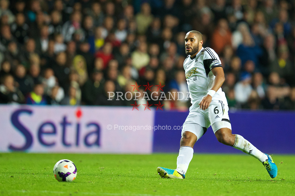 SWANSEA, WALES - Monday, September 16, 2013: Swansea City's captain Ashley Williams in action against Liverpool during the Premiership match at the Liberty Stadium. (Pic by David Rawcliffe/Propaganda)