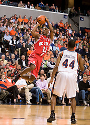 North Carolina State forward Gavin Grant (11) leaps for a shot against UVA.  The Virginia Cavaliers men's basketball team defeated the North Carolina State Wolfpack 78-60 at the John Paul Jones Arena in Charlottesville, VA on February 24, 2008.
