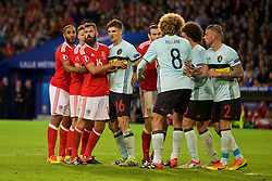 LILLE, FRANCE - Friday, July 1, 2016: Wales' captain Ashley Williams, James Chester and Joe Ledley prepare for a corner during the UEFA Euro 2016 Championship Quarter-Final match against Belgium at the Stade Pierre Mauroy. (Pic by David Rawcliffe/Propaganda)