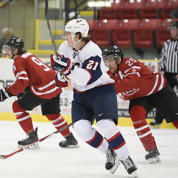WELLINGTON, - Dec 11, 2015 -  Exhibition Game 2- Team USA vs Team Canada East at the 2015 World Junior A Challenge at the Wellington District Community Centre, ON. Chase Pearson #21 of Team United States pursues the play during the second period.<br /> (Photo: Andy Corneau / OJHL Images)