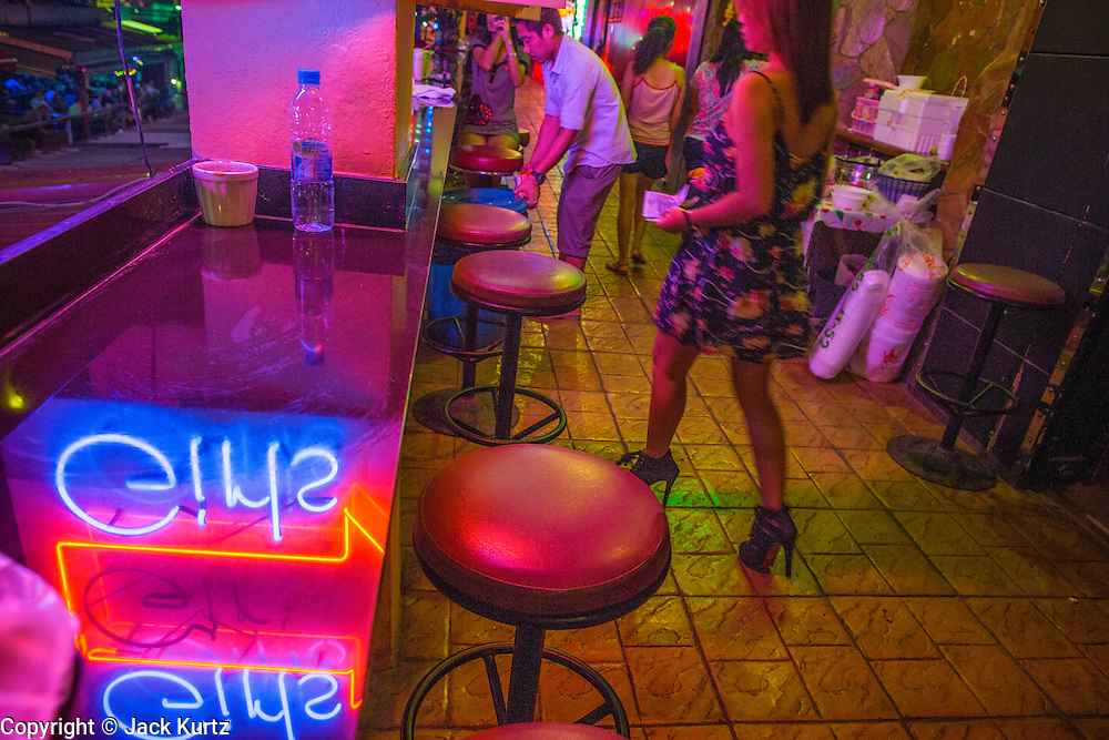 "18 JANUARY 2013 - BANGKOK, THAILAND: The entrance to DC10, a ""go-go bar"" in the Nana Entertainment District in Bangkok. Prostitution in Thailand is technically illegal, although in practice it is tolerated and partly regulated. Prostitution is practiced openly throughout the country. The number of prostitutes is difficult to determine, estimates vary widely. Since the Vietnam War, Thailand has gained international notoriety among travelers from many countries as a sex tourism destination. One estimate published in 2003 placed the trade at US$ 4.3 billion per year or about three percent of the Thai economy. It has been suggested that at least 10% of tourist dollars may be spent on the sex trade. According to a 2001 report by the World Health Organisation: ""There are between 150,000 and 200,000 sex workers (in Thailand).""          PHOTO BY JACK KURTZ"