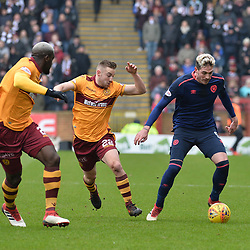 Cedric Kipre (Motherwell) and Allan Campbell (Motherwell) and Kyle Lafferty (Hearts) during the Scottish Cup quarter final between Motherwell and Hearts at Fir Park, where the home side made it into the semi final draw with a win.<br /> <br /> <br /> (c) Dave Johnston | sportPix.org.uk
