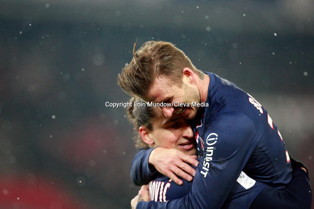 David Beckham celebrates with goal scorer Zlatan Ibrahimovic.  PSG v Marseille, Ligue 1, Parc Des Princes, Paris, France, 24th Feb 2013. ..CREDIT MUST READ - EOIN MUNDOW/CLEVA MEDIA