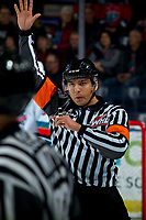 KELOWNA, BC - FEBRUARY 15: Referee Brayden Arcand raises his arm for the face-off at the Kelowna Rockets against the Red Deer Rebels at Prospera Place on February 15, 2020 in Kelowna, Canada. (Photo by Marissa Baecker/Shoot the Breeze)