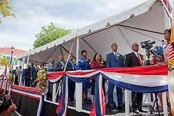 The Senators salute the Virgin Islands flag during the Virgin Islands March.  St. Thomas Swearing-In Ceremony for the 32nd Legislature of the US Virgin Islands.  Emancipation Garden.  St. Thomas, VI.  9 January 2017.  © Aisha-Zakiya Boyd
