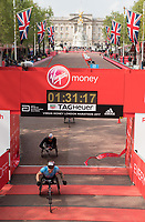 David Weir GBR crosses the finish line winning the Elite Wheelchair Men's Race with MarcelHug SUI in second place. The Virgin Money London Marathon, 23rd April 2017.<br /> <br /> Photo: Thomas Lovelock for Virgin Money London Marathon<br /> <br /> For further information: media@londonmarathonevents.co.uk