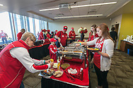 Badger fans dish up food at the Homecoming Badger Bash celebration in 2014.