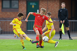 NEWPORT, WALES - Thursday, August 4, 2016: orth Wales Academy Boys' Harvey Tattum [L] and Regional Development Boys' Eli King [C] during the Welsh Football Trust Cymru Cup 2016 at Newport Stadium. (Pic by Paul Greenwood/Propaganda)