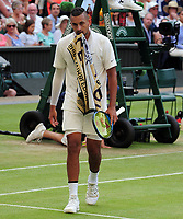 Tennis - 2019 Wimbledon Championships - Week One, Thursday (Day four)<br /> <br /> Men's singles, 2nd Round Nick Kyrios (AUS) v Rafael Nadal (ESP)<br /> <br /> Nick Kyrios walks with the towel in his mouth on Centre Court <br /> <br /> COLORSPORT/ANDREW COWIE