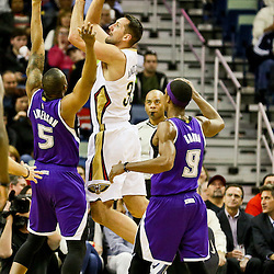Jan 28, 2016; New Orleans, LA, USA; New Orleans Pelicans forward Ryan Anderson (33) shoots over Sacramento Kings guard James Anderson (5) and guard Rajon Rondo (9) during the first quarter of a game at the Smoothie King Center. Mandatory Credit: Derick E. Hingle-USA TODAY Sports