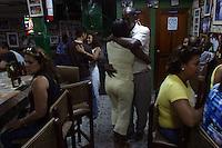 "Locals dance at Donde Fidel, a popular salsa bar in the ""Old City"" of Cartagena, a unique travel destination on Colombia's Caribbean coast. (Photo/Scott Dalton)"