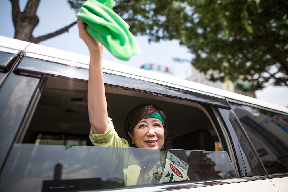 TOKYO, JAPAN - JULY 20 : Yuriko Koike, a Liberal Democratic Party lawmaker and former defense minister waves a green cloth given by her supporter after her speech campaign for the July 31 Tokyo gubernatorial election in front of Gotanda Station in Tokyo, Japan on Wednesday, July 20, 2016.   (Photo by Richard Atrero de Guzman/NUR Photo)