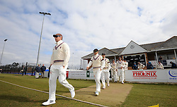 The Somerset team led by Somerset's Marcus Trescothick walk out to the wicket for the first time this season.  - Photo mandatory by-line: Harry Trump/JMP - Mobile: 07966 386802 - 23/03/15 - SPORT - CRICKET - Pre Season Fixture - Day 1 - Somerset v Glamorgan - Taunton Vale Cricket Club, Somerset, England.