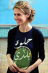 File photo - Syrian First Lady Asma El Assad plays badminton, bare feet, with a T-shirt saying 'Sweet is my country', as she visits the Syrian paralympic team at Al Fayhaa sport complex, in Damascus, Syria on June 20, 2012. Death toll just reached 15.000 killed, after 15 months of troubles in her country. Syria's British-born first lady Asma Assad has begun treatment for breast cancer. The Syrian presidency posted on its Facebook page a photo of President Bashar Assad sitting next to his wife in a hospital room. Photo by ABACAPRESS.COM