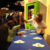 Icc Nursing Volunteer Amber Alexander, high-fives Jalyn Osborne, 5, for winning the Cloud 9 game Saturday at Healthworks 9th Birthday Celebration