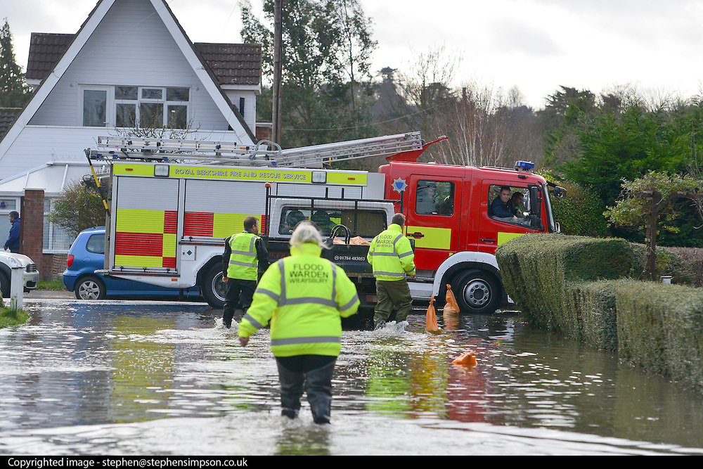 © Licensed to London News Pictures. 09/02/2014. Wraysbury, UK . The fire brigade talk to flood wardens. Flooding in Wraysbury in Berkshire today 9th February 2014 after the River Thames burst its banks. Photo credit : Stephen Simpson/LNP