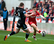 Scarlets' Steff Evans threads one past Glasgow Warriors' Stuart Hogg<br /> <br /> Photographer Simon King/Replay Images<br /> <br /> Guinness PRO14 Round 19 - Scarlets v Glasgow Warriors - Saturday 7th April 2018 - Parc Y Scarlets - Llanelli<br /> <br /> World Copyright &copy; Replay Images . All rights reserved. info@replayimages.co.uk - http://replayimages.co.uk