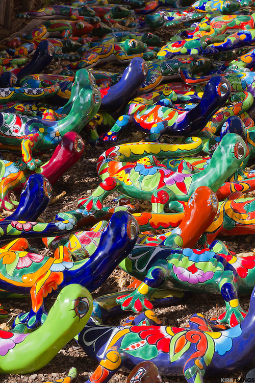 Mexican Talavera Ceramic Lizards sitting the sun waiting for someone to take them home.