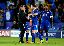 Leicester City manager Craig Shakespeare celebrates with Christian Fuchs of Leicester City after their win over Sevilla - Mandatory by-line: Robbie Stephenson/JMP - 14/03/2017 - FOOTBALL - King Power Stadium - Leicester, England - Leicester City v Sevilla - UEFA Champions League round of 16, second leg