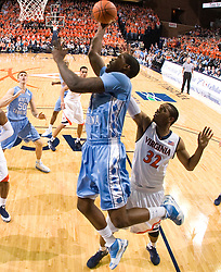 North Carolina forward Deon Thompson (21) shoots a layup past Virginia forward Mike Scott (32).  The the #5 ranked North Carolina Tar Heels defeated the Virginia Cavaliers 83-61 in NCAA Basketball at the John Paul Jones Arena on the Grounds of the University of Virginia in Charlottesville, VA on January 15, 2009.