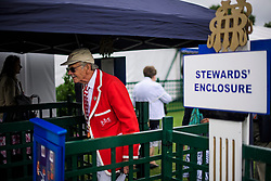 © Licensed to London News Pictures. 28/06/2017. London, UK. A man in rowing club colours leaves the Stewards Enclosure on day one of the Henley Royal Regatta, set on the River Thames by the town of Henley-on-Thames in England.  Established in 1839, the five day international rowing event, raced over a course of 2,112 meters (1 mile 550 yards), is considered an important part of the English social season. Photo credit: Ben Cawthra/LNP