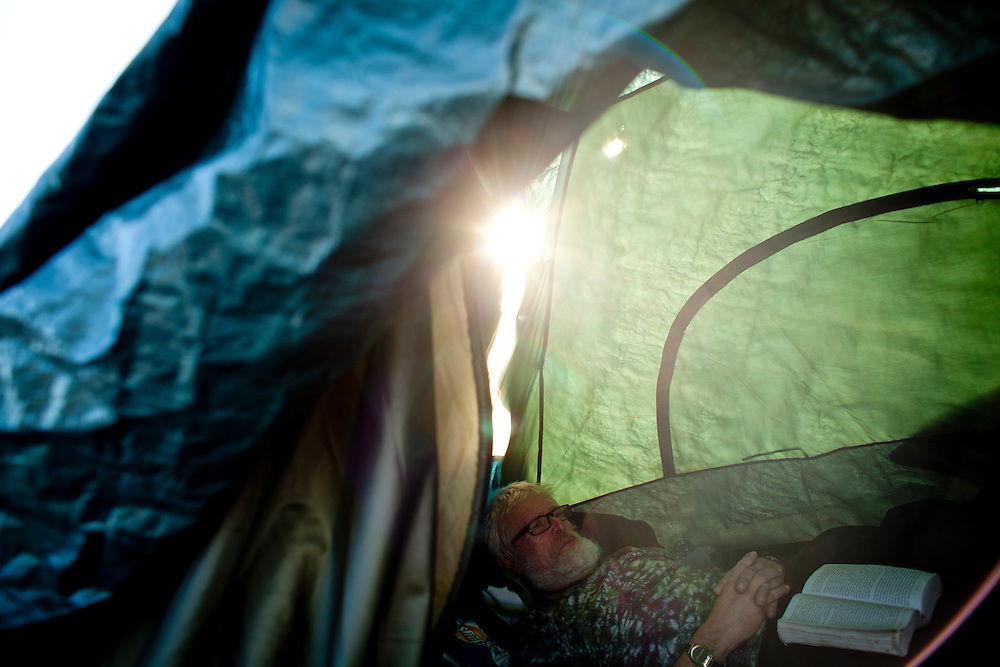 Melvin Sargent relaxes in his tent at the SafeGround camp in Sacramento, Calif., January 14, 2011.