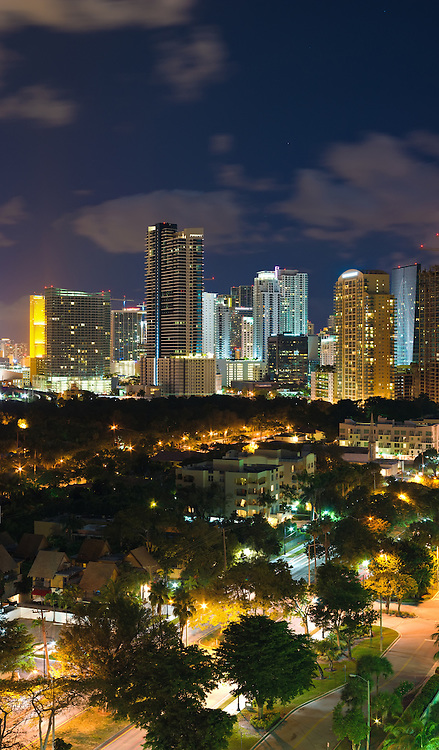 Vertical panorama of downtown Miami, Florida office and residential condominium buildings and Brickell Avenue at night. WATERMARKS WILL NOT APPEAR ON PRINTS OR LICENSED IMAGES.