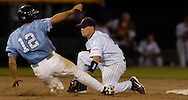 06/16/2006 University of North Carolina's Josh Horton is tagged out stealing by  cal State Fulerton's Blake Davis during, game 2 of the College World Series in Omaha Nebraska Friday evening..(photo by  Chris Machian /Prairie Pixel Group)