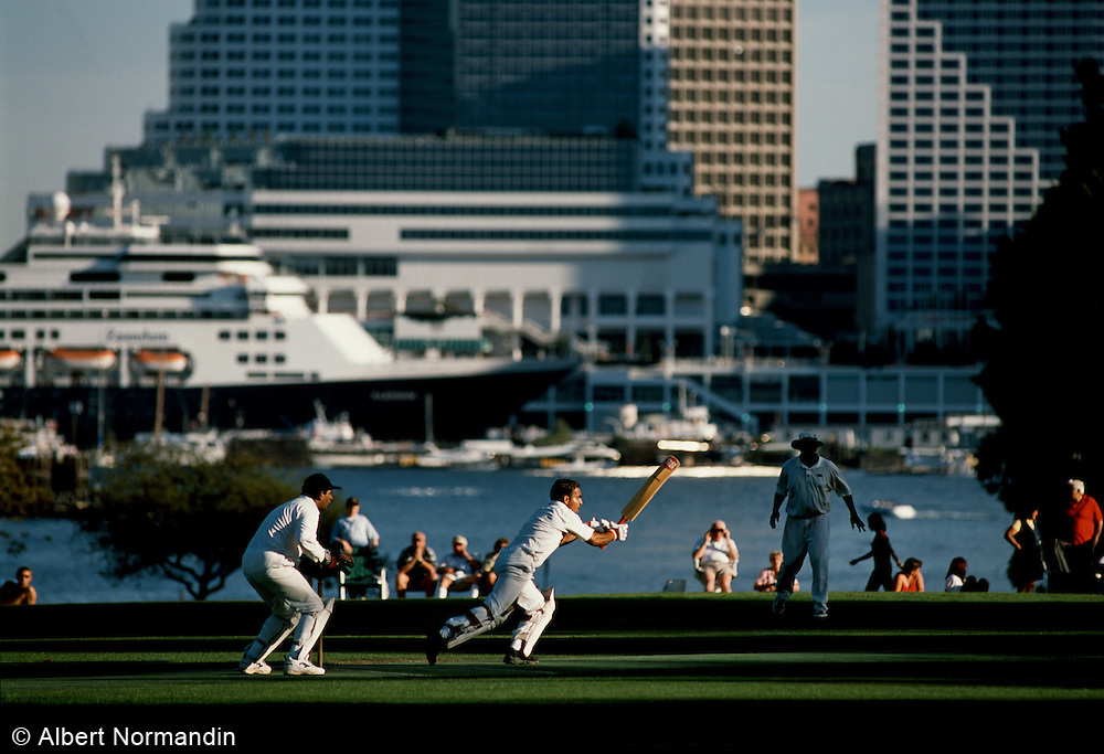 Cricket game in Stanley Park with city in background