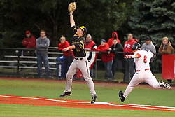 25 May 2013:  Zac Johnson just beats the throw to first baseman Casey Gillaspie during an NCAA division 1 Missouri Valley Conference (MVC) Baseball Tournament game between the Wichita State Shockers and the Illinois State Redbirds on Duffy Bass Field, Normal IL