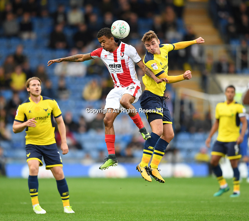 August 8th 2017, Kassam Stadium, Oxford, England; Carabao Cup First Round; Oxford United versus Cheltenham; Ryan Ledson of Oxford United and Jerell Sellars of Cheltenham compete in the air