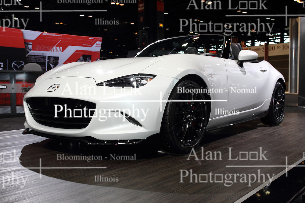 12 February 2015:  2016 MAZDA MX-5: The Mazda MX-5 two-seat roadster has a long association with the Chicago Auto Show. It was at the 81st CAS, Feb. 11-19, 1989, that the original Mazda MX-5 Miata made its public debut.  Continuing that tradition, Mazda will be displaying the new 2016 MX-5, at the 2015 Chicago show. This is the fourth-generation of the world&rsquo;s best-selling roadster, with its compact open-top body, a front-midship engine rear-wheel drive configuration, 50:50 front-rear weight distribution, and an affordable price. The 2016 Mazda MX-5 is distinguished by a fresh approach to Mazda&rsquo;s KODO design language, which combines beautiful proportions with body surfaces that express the contrast between stillness and motion. A snug feeling cabin has been moved a little toward the rear to create the appearance that the occupants are sitting at the body&rsquo;s midpoint. The heart of the new MX-5 is a new generation Skyactiv 2.0-liter four-cylinder engine, and can be mated to the buyer&rsquo;s choice of either a six-speed manual or automatic transmission, specially tuned for the MX-5. It is the most compact of any generation MX-5 so far and is more than 220 pounds lighter than the model it replaces, promising a dramatic leap in Jinba-ittai driving fun. Some of the mass savings comes from the further use of aluminum components and the weight of the soft top is reduced. After visiting the Chicago show, stop by a local Mazda dealership and experience the top down enjoyment of feeling the breeze and the smile on your face while driving the fourth generation MX-5 Miata.<br /> <br /> First staged in 1901, the Chicago Auto Show is the largest auto show in North America and has been held more times than any other auto exposition on the continent. The 2015 show marks the 107th edition of the Chicago Auto Show. It has been  presented by the Chicago Automobile Trade Association (CATA) since 1935.  It is held at McCormick Place, Chicago Illinois