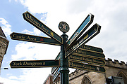 Street sign in York city centre, UK, giving directions to York Dungeon, Mansion House, Riverboats, Railway Station, York Bewery, Post Office, Minster Area, Park and Ride, The Shambles, National Railway Museum and other attractions.