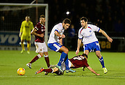 Northampton Town midfielder Lawson D'Ath is fouled  during the Sky Bet League 2 match between Northampton Town and Portsmouth at Sixfields Stadium, Northampton, England on 19 December 2015. Photo by Dennis Goodwin.