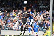Jermaine Beckford challenged by Reece Brown during the EFL Sky Bet League 1 match between Rochdale and Bury at Spotland, Rochdale, England on 26 August 2017. Photo by Daniel Youngs.