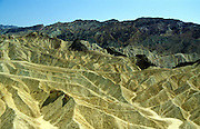 Badlands landscape heavily eroded gulleying near Zabriskie Point, Death Valley national park, California, USA